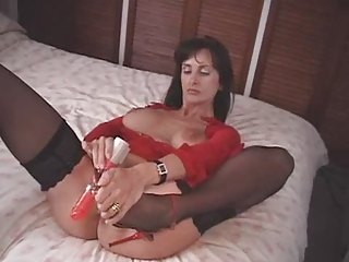 british milf bonks herself with a couple of high
